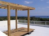 rooftop terrace with wooden pergola