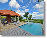 upscale villa with ocean and forest views, set up on a hilltop of Sosua