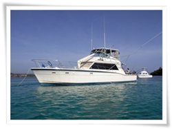 private yacht rental in Sosua, this hatteras is a 52 feet boat fit for parties and sailing