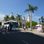 tourist bus arriving at the central park, in Puerto Plata.
