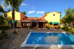 This villa rental is a classic Spanish style home in a gated community
