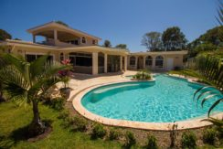 The villa seen from the lush green garden