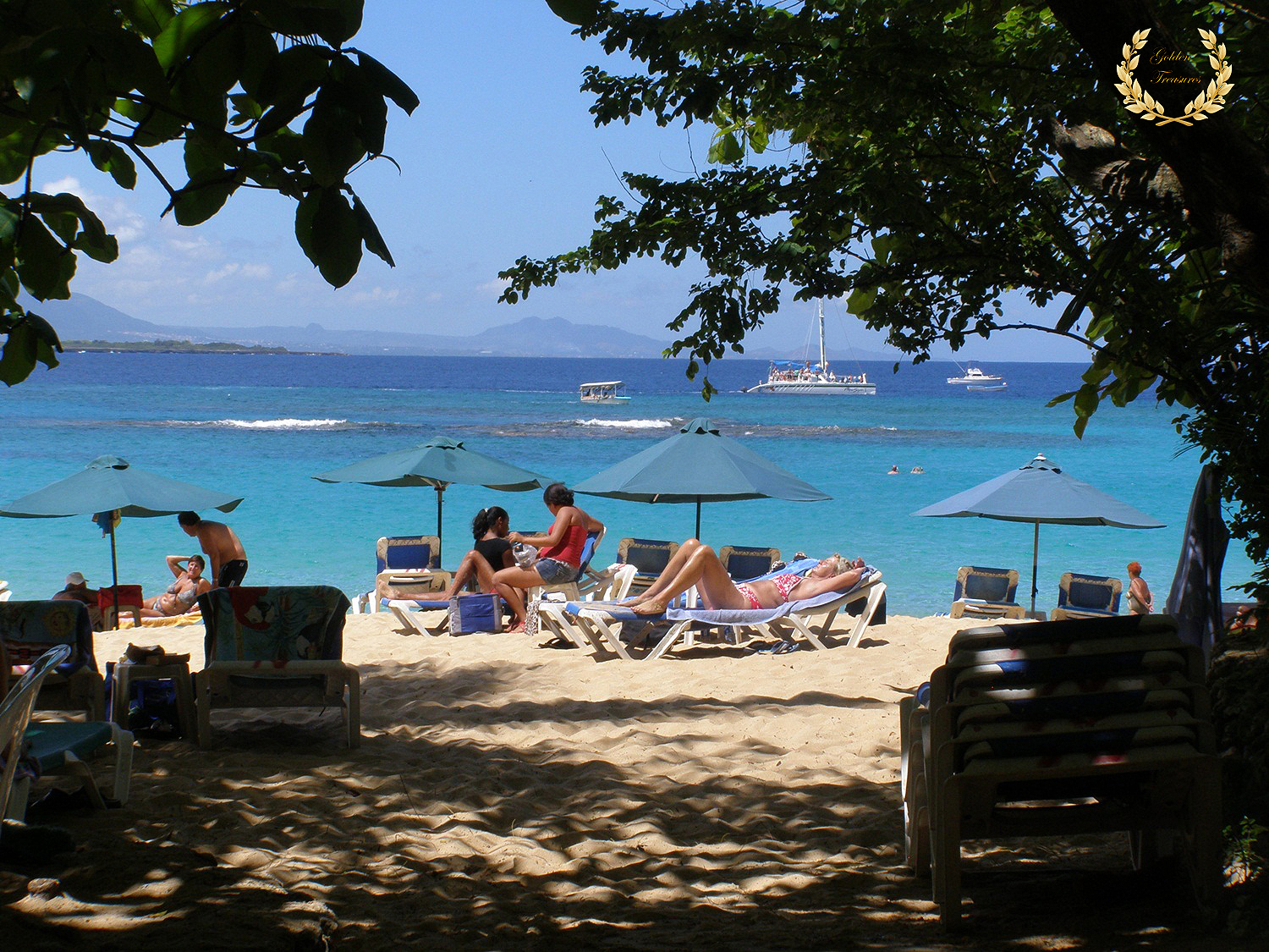 Tourists Sprawl In Chaise Lounges At Sosua Beach On A Sunday Afternoon